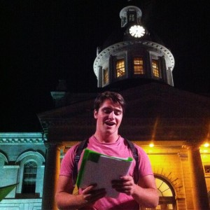 Callum Lurie rehearses Bottle and Glass out front of Kingston City Hall.